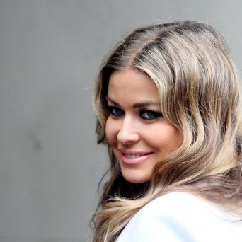 Carmen Electra was coy as she talked about Simon Cowell