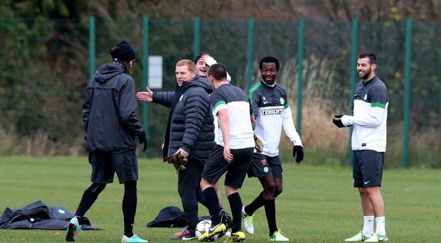 Celtic manager Neil Lennon jokes with his players during a training session at the Lennoxtown Training Complex, Glasgow