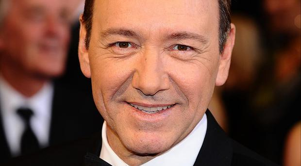 Kevin Spacey will co-host the party with David Furnish