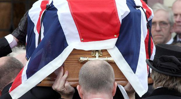 Prison officers carry the coffin of murdered colleague David Black to Molesworth Presbyterian Church in Cookstown, Co Tyrone