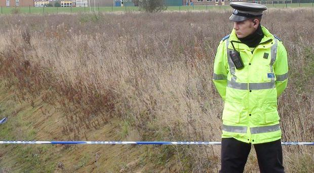 Police at the scene where the body of a teenage boy has been found in a ditch in Edenthorpe, Doncaster