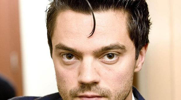 Dominic Cooper is being tipped to play a racing driver