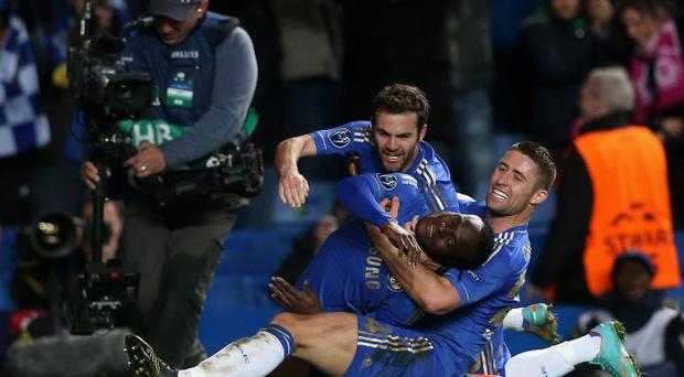 LONDON, ENGLAND - NOVEMBER 07: Victor Moses of Chelsea celebrates his goal with Juan Mata and Gary Cahill during the UEFA Champions League Group E match between Chelsea and Shakhtar Donetsk at Stamford Bridge on November 7, 2012 in London, England. (Photo by Scott Heavey/Getty Images)