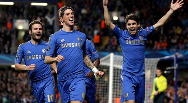 Chelsea's Fernando Torres (centre) celebrates with his team-mates after scoring his side's first goal during the UEFA Champions League match at the Stamford Bridge, London. PRESS ASSOCIATION Photo. Picture date: Wednesday November 7, 2012. See PA story SOCCER Chelsea. Photo credit should read: Nick Potts/PA Wire.