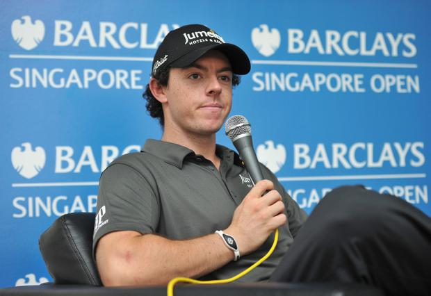 SINGAPORE - NOVEMBER 07: Rory McIlroy talks with the media during his press conference prior to the start of the Barclays Singapore Open at the Sentosa Golf Club on November 7, 2012 in Singapore. (Photo by Stuart Franklin/Getty Images)