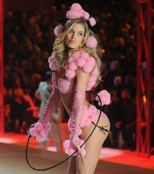 NEW YORK, NY - NOVEMBER 07: Victoria's Secret Angel Doutzen Kroes walks the runway during the 2012 Victoria's Secret Fashion Show at the Lexington Avenue Armory on November 7, 2012 in New York City. (Photo by Jamie McCarthy/Getty Images)