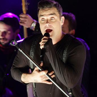 Robbie Williams likes to rap to his baby daughter Teddy