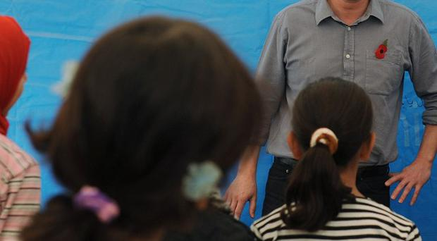 Prime Minister David Cameron meets children and teachers in a classroom at the Za'atri refugee camp near the Syrian - Jordanian border