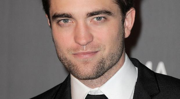 Robert Pattinson reckons his on-screen kissing needs some work