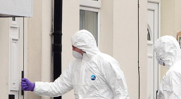 Police forensic experts at the scene of a fatal shooting of Danny McKay in the Longlands Road area of Newtownabbey, Co Antrimlast month