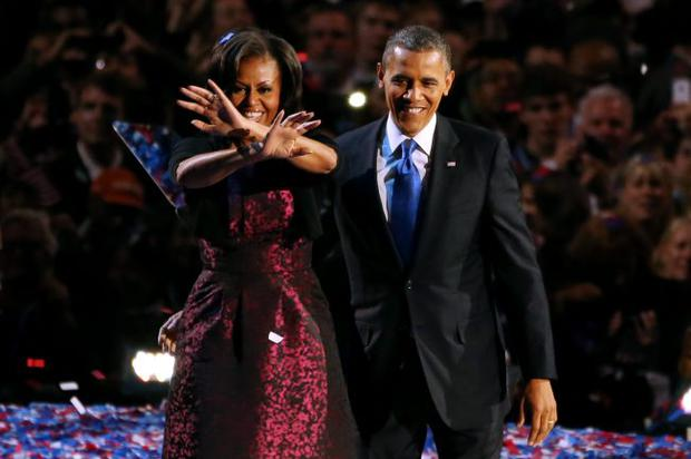 U.S. President Barack Obama stands on stage with first lady Michelle Obama after his victory speech on election night