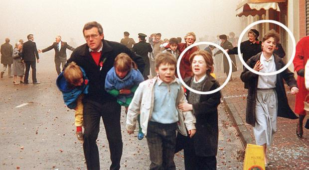 Julie O'Donnell (circled above right) in our photograph of fleeing children in Enniskillen in 1987. Circled left is Julie's sister Shirley Robinson