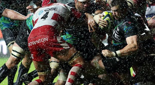 Ospreys' Morgan Allen is driven over the try line for the winning score