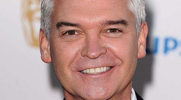 ITV presenter Phillip Schofield handed Prime Minister David Cameron a list of alleged paedophiles during a live TV interview