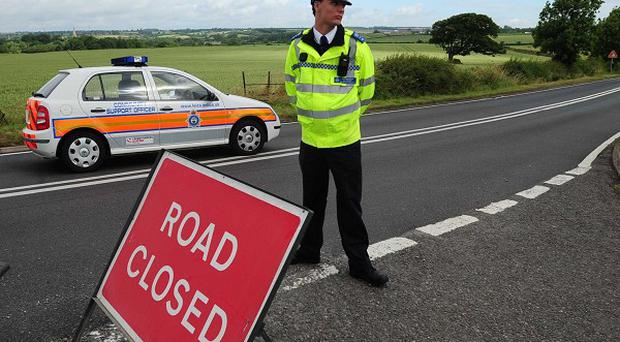 A crash between a car and a lorry has left three men dead