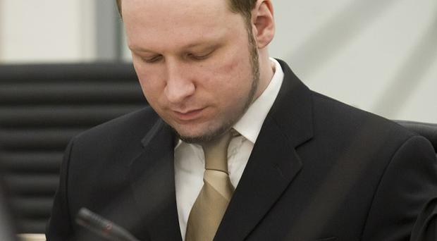Mass-murderer Anders Behring Breivik looking at this own notes during his trial (AP)