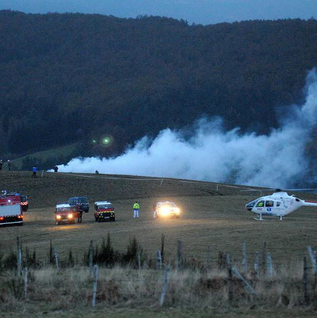 Police, firefighters and a medical helicopter near the scene in southern France where an Algerian military cargo plane crashed (AP)