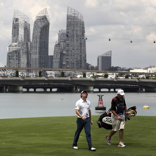 Rory McIlroy is down in joint 29th place on one under (AP)