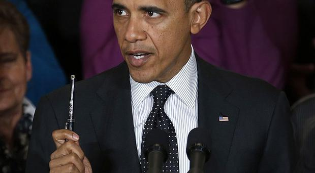 President Barack Obama speaks about the US economy and its deficit, in the East Room of the White House (AP)