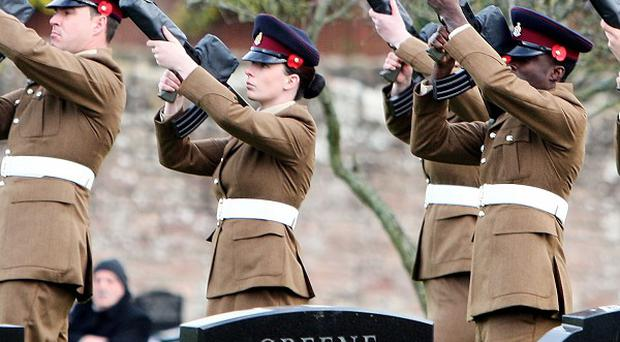 Corporal Channing Day's colleagues fire a volley of shots as she is laid to rest in her home town of Comber, Co Down