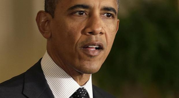 President Barack Obama has refused to give ground on tax rises for the rich (AP Photo)
