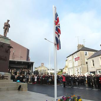 Enniskillen comes to a standstill to mark the 25th anniversary of the IRA Poppy Day bombing atrocity