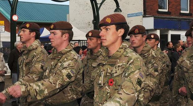 The King's Royal Hussars march through the streets of Leyland to mark their return from service in Afghanistan