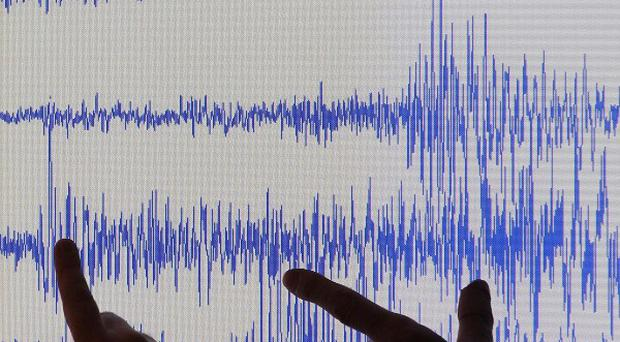 A strong earthquake has struck northern Burma, leaving as many as 12 people feared dead