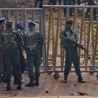 Army soldiers and police officers stand guard at the entrance of a prison in Colombo, Sri Lanka (AP)