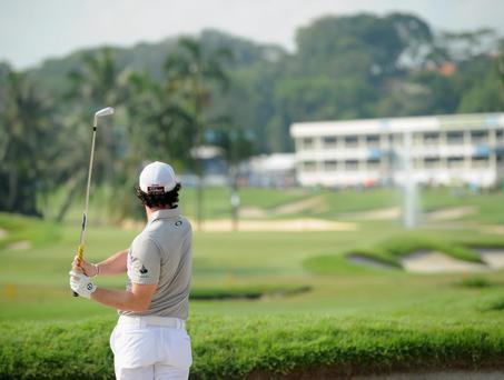 SINGAPORE - NOVEMBER 11: Rory McIlroy of Northern Ireland plays a shot during the continuation of the weather delayed third round of the Barclays Singapore Open at the Sentosa Golf Club on November 11, 2012 in Singapore. (Photo by Stuart Franklin/Getty Images)