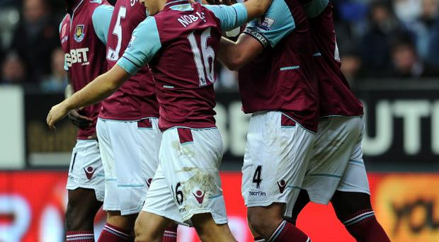 NEWCASTLE UPON TYNE, ENGLAND - NOVEMBER 11: Kevin Nolan of West Ham United is congratulated by his team-mates after scoring the opening goal during the Barclays Premier League match between Newcastle United and West Ham United at St James' Park on November 11, 2012 in Newcastle upon Tyne, England. (Photo by Chris Brunskill/Getty Images)