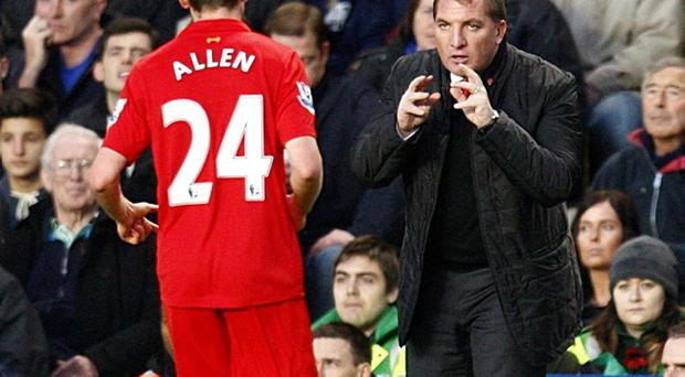 Liverpool manager Brendan Rodgers (right) gives instructions to Joe Allen (left) on the touchline during the Barclays Premier League match at Stamford Bridge, London