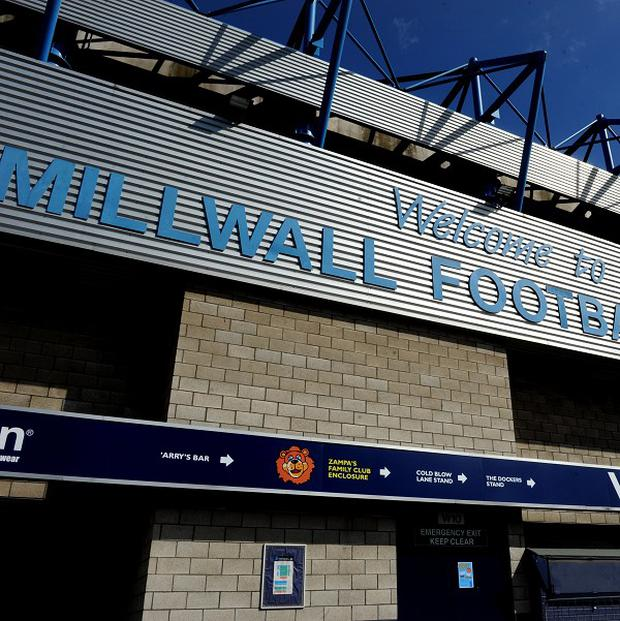 Six people were questioned by police after an offensive banner was unfurled at the New Den, home of Millwall FC