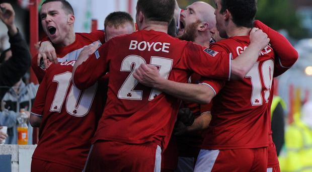 Cliftonville players celebrate sealing the result over Linfield at Solitude