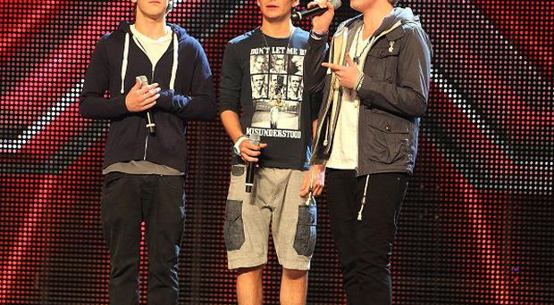 District 3 are out of The X Factor after a battle of the boybands