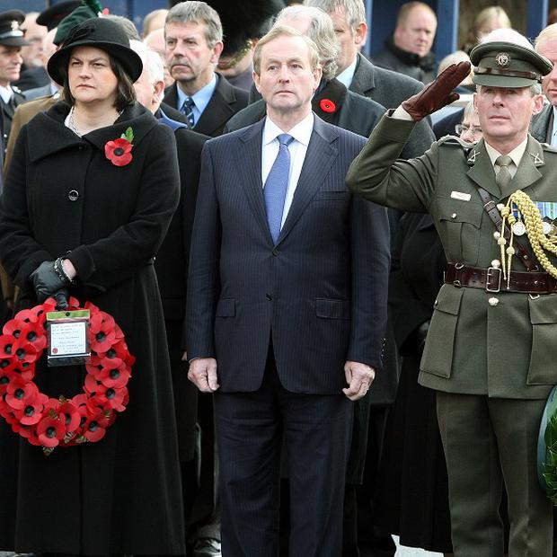 Taoiseach Enda Kenny with Stormont Minister Arlene Foster attending a commemoration ceremony at Enniskillen cenotaph