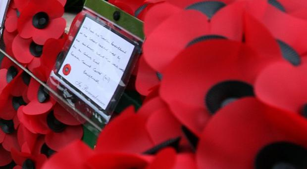 Kent Police have arrested a man after a picture of a burning poppy was posted on a social networking website