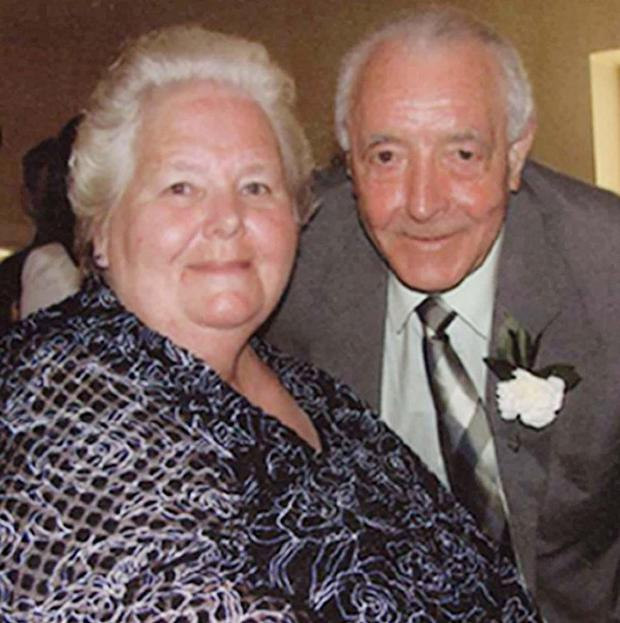 Bertie Acheson, pictured with his wife Sheila, died after he confronted a burglar at his home in Coleraine