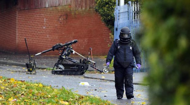 An army bomb disposal expert walks away from the suspcious device on Ballymagarry lane in west Belfast