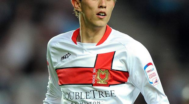 Uncapped MK Dons player Tom Flanagan has been named in the Northern Ireland Under-21 squad