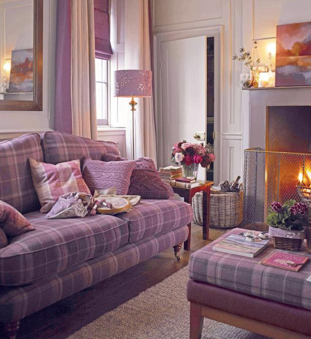Undated Handout Photo of Lynden two-seater sofa, upholstered in Highland Grape, £1,550; Trafalgar footstool in Highland Grape, £700; Winston floor lamp, £175 and made to order shade in Pussy Willow Grape, from £34, Laura Ashley. See PA Feature INTERIORS Cosy. Picture credit should read: PA Photo/Handout. WARNING: This picture must only be used to accompany PA Feature INTERIORS Cosy.