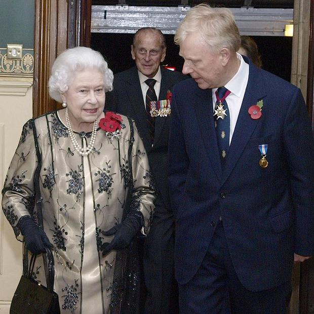 The Queen is greeted by the President of the Royal British Legion Vice- Admiral Peter Wilkinson at the Royal Albert Hall