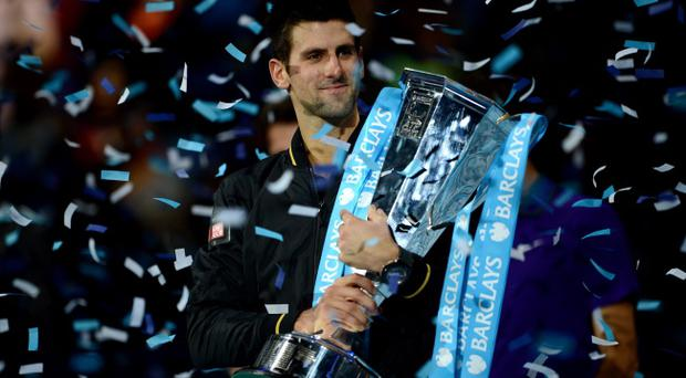 LONDON, ENGLAND - NOVEMBER 12: Novak Djokovic of Serbia lifts the trophy as he celebrates victory after his men's singles final match against Roger Federer of Switzerland during day eight of the ATP World Tour Finals at O2 Arena on November 12, 2012 in London, England. (Photo by Michael Regan/Getty Images) ***BESTPIX***