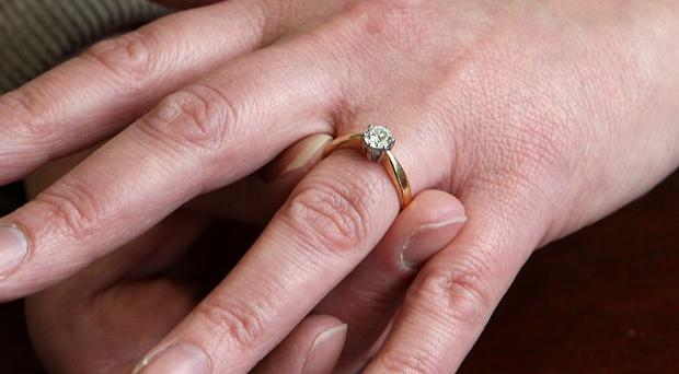 A man stole wedding rings from an elderly woman at her home in south Belfast