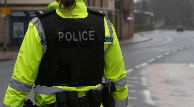 The PSNI is investigating a viable explosive device found near a school in north Belfast