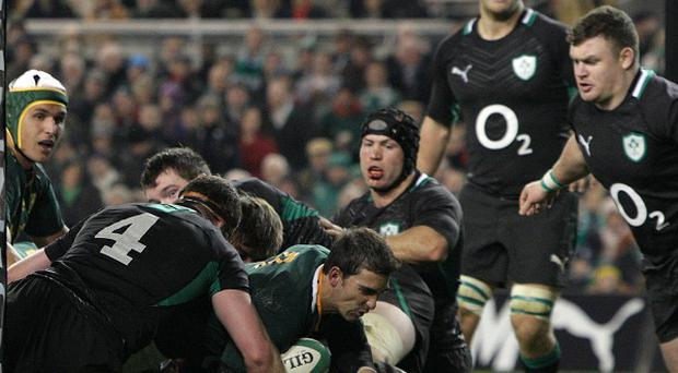 Ruan Pienaar, centre, scored the game's only try
