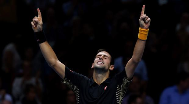 LONDON, ENGLAND - NOVEMBER 12: Novak Djokovic of Serbia celebrates match point during his men's singles final match against Roger Federer of Switzerland during day eight of the ATP World Tour Finals at O2 Arena on November 12, 2012 in London, England. (Photo by Julian Finney/Getty Images)