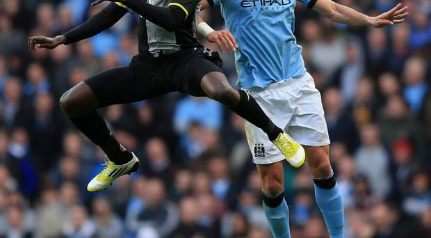 Aleksandar Kolarov in action against Emmanuel Adebayor at the weekend