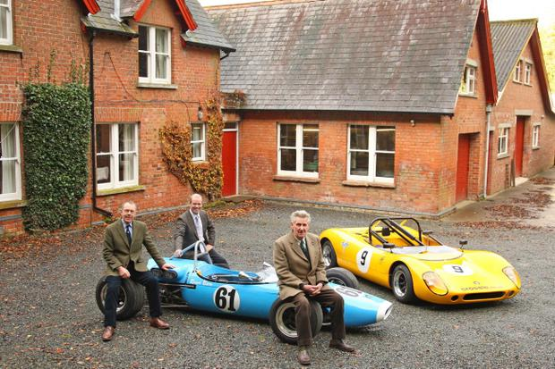 John Crossle (front) with outgoing managing director Arnie Black (left) and the new owner of Crossle Cars Paul McMorran