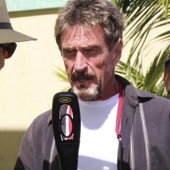 Software company founder John McAfee said he feared police in Belize would kill him if they found him (AP)